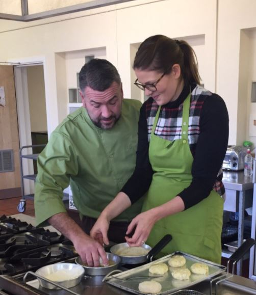 Area Manage Mark and Company Nutritionist Laura preparing a delicious spread